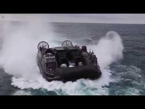 Navy Landing Craft Air Cushion Transport Marines to USS Kearsarge