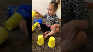 Little kid plays with toys