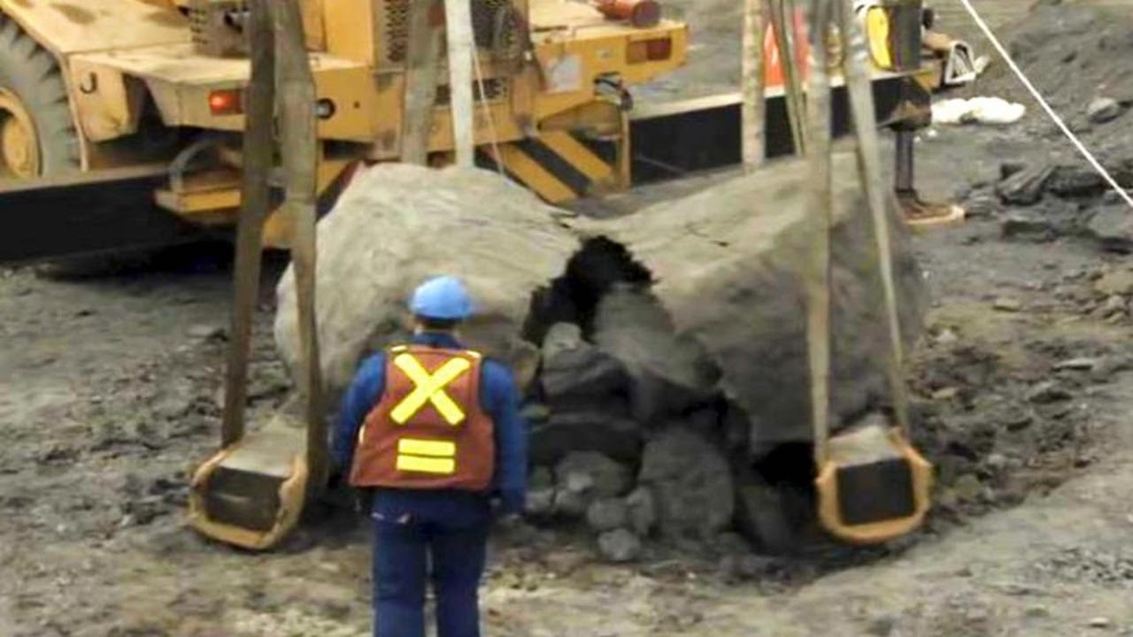 Download Excavator Busts Open Rock, Had No Idea What He's Done