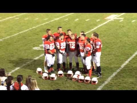 Saginaw Michigan Lutheran Seminary football players sing national anthem before playoff win