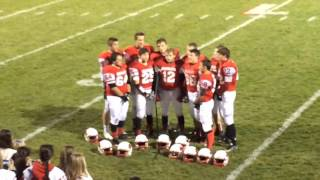 Saginaw Michigan Lutheran Seminary football players sing national anthem before playoff win