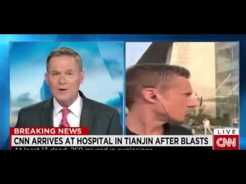 CNN Breaking News Live explosion in China Tianjin some people stop the reporter