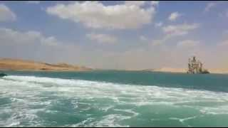 Navigation in the Suez Canal and the new communication channel 65 kilometers high and waves