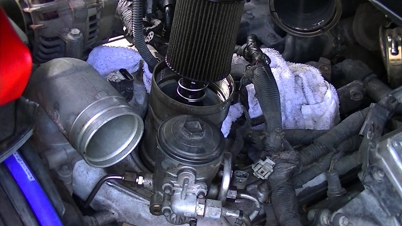 medium resolution of oil cooler replacement 3 removing oil filter and fuel filter housing youtube