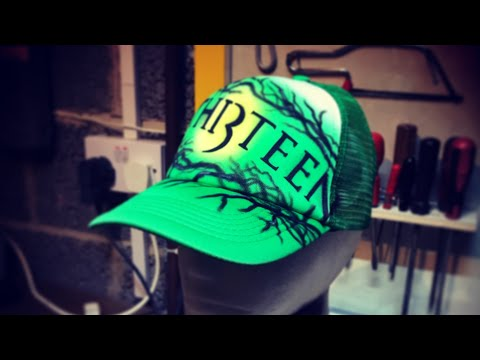 Airbrushing a Th13teen Hat
