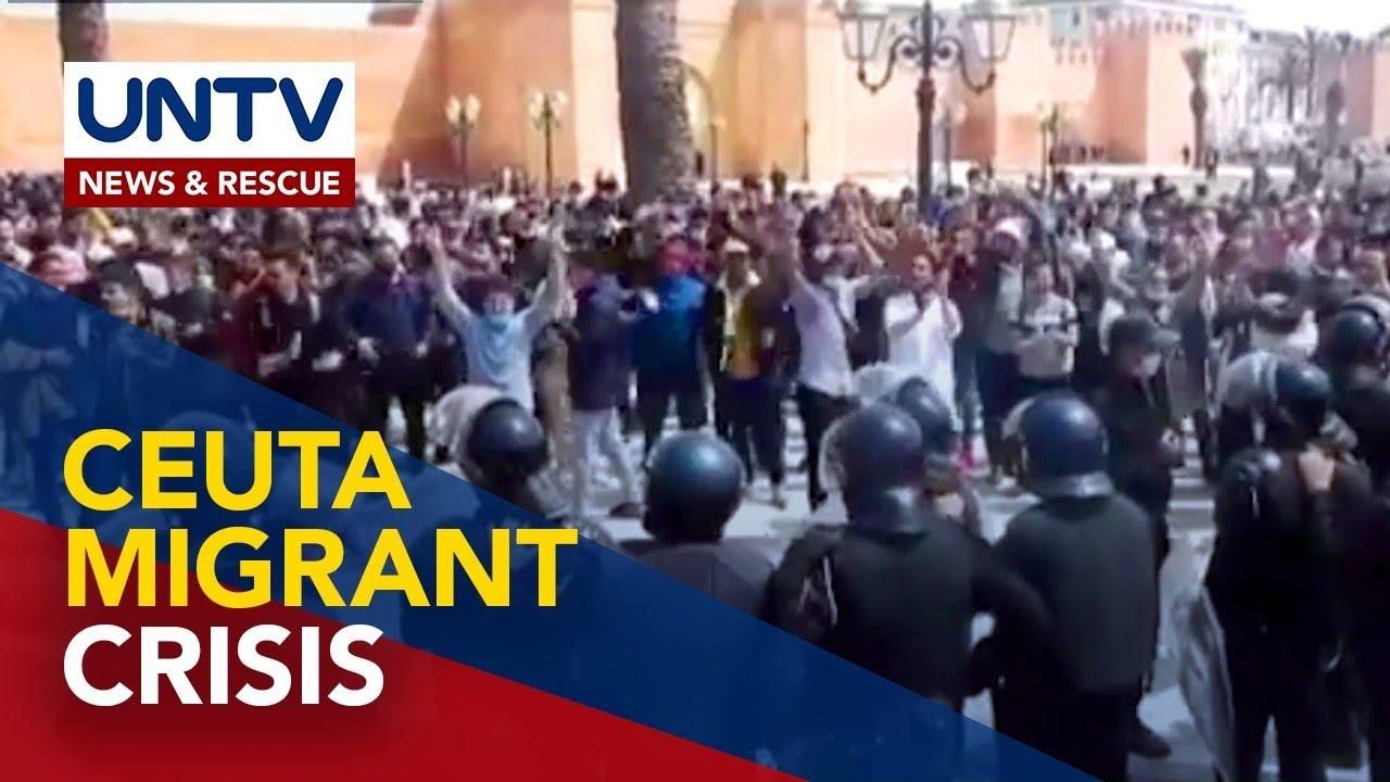 Thousand migrants swim from Morocco to Spanish border