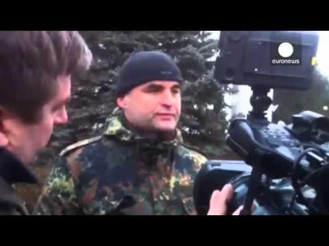Ukraine denounces 'armed invasion' as suspected Russian forces raid Crimea airports