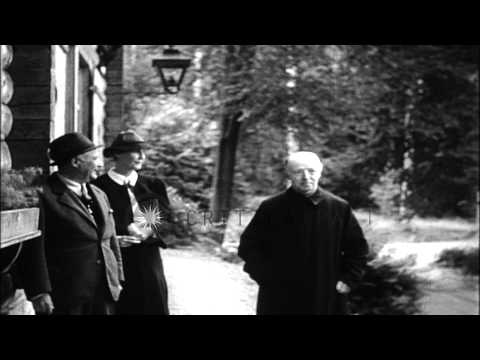 Arbitrator of Czech Sudeten Crisis Lord Runciman and his wife at a castle estate ...HD Stock Footage