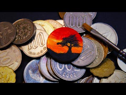 Paints Miniature landscape on coins