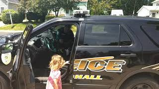 Police officer let's little kids play in his police car