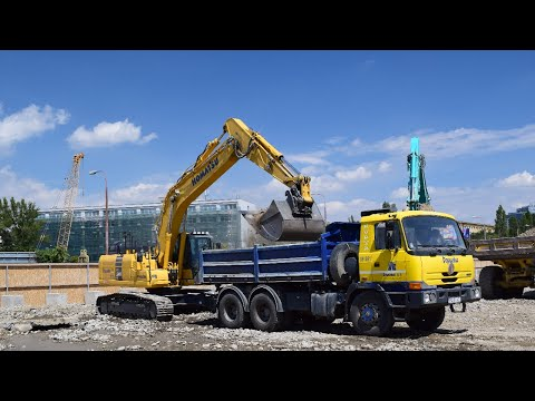 KOMATSU PC240LC crawler excavator  loading TATRA truck on construction site