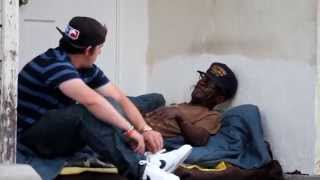 Giving A Pair Of Nikes Shoes To The Homeless