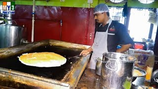 Thick Indian Crepe Topping with Onions and Tomato - Street Food