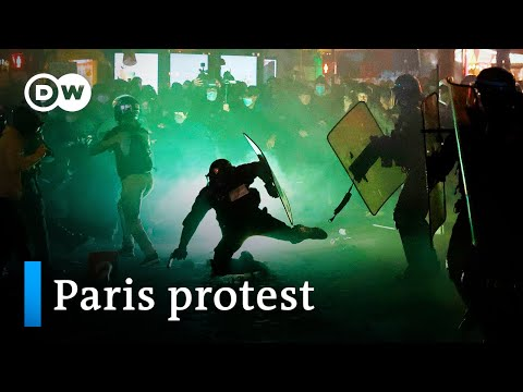 Paris police clash with protesters over new security bill | DW News
