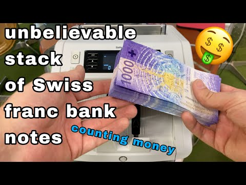 unbelievable stack of swiss 1000 CHF  franc bank notes counting by money machine