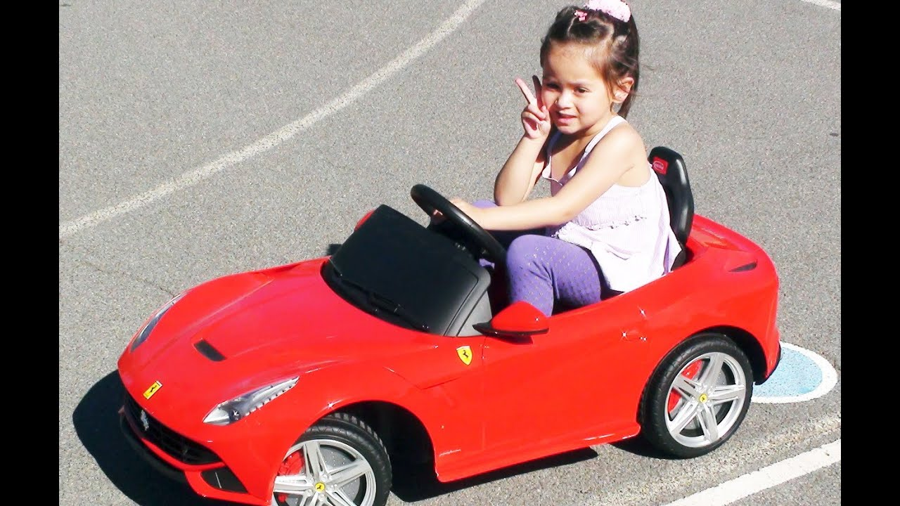 kid driving ferrari f12 berlinetta ride on car