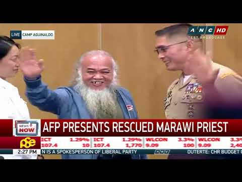 Priest held hostage by Maute faces media
