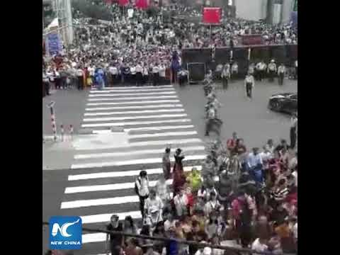 Human wall! Watch how China's armed police direct traffic in Shanghai