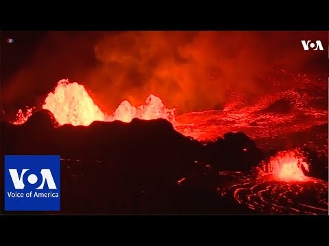 Lava from Hawaii's erupting Kilauea volcano lit up the night on Tuesday (May 22)