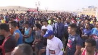 Thousands run a marathon through Egypt's pyramids