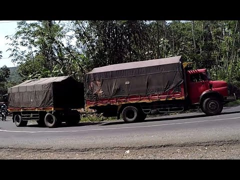 skil sopir TRUK GANDENG melewati tikungan times | truck HINO, FUSO, UD, MERCY