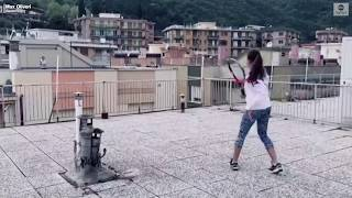 People in Italy play tennis on rooftop during coronavirus lockdown ABC News