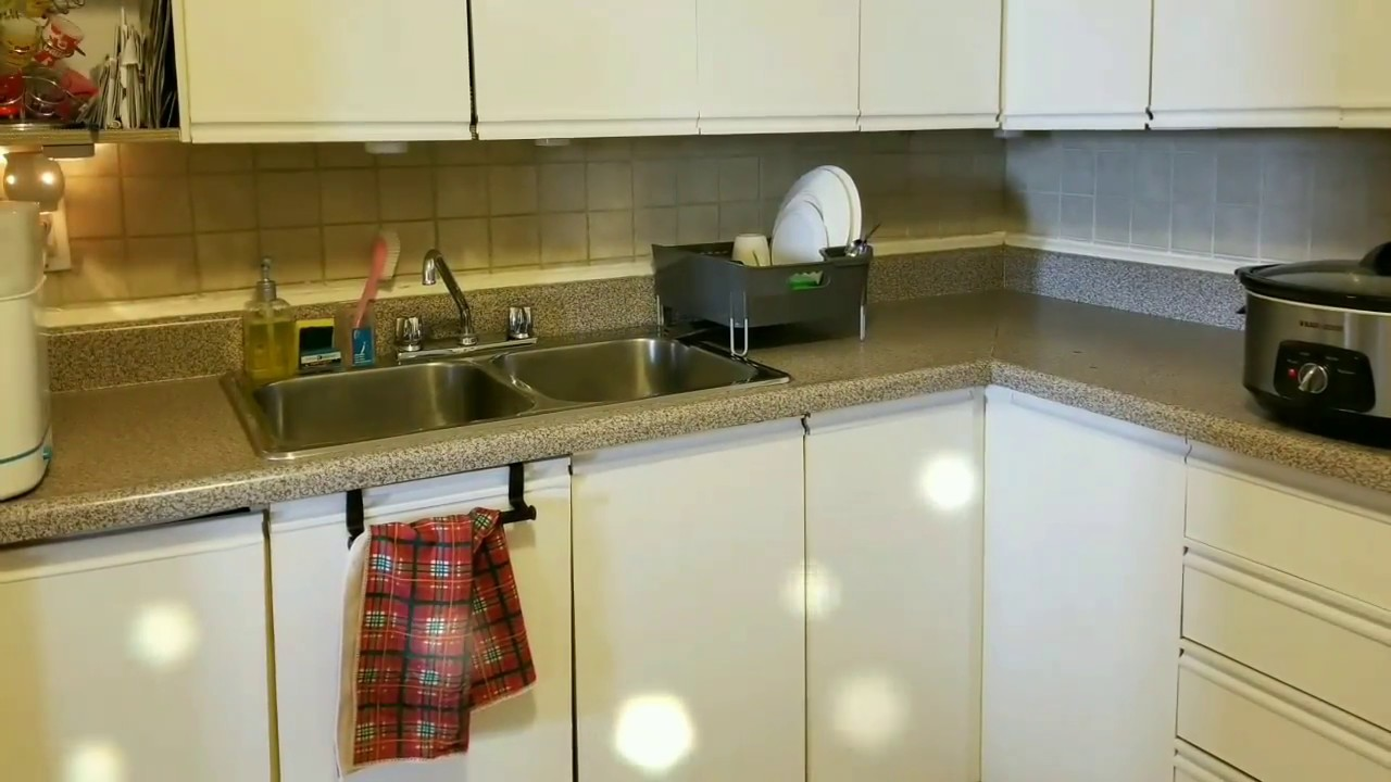 contact paper on ugly cabinets/kitchen reface/ under $20/apartment on ugly apartment design, ugly apartment doors, ugly apartment wallpaper,