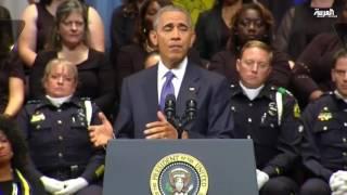 أوباما وبوش الإبن يجتمعون بقاعة واحدة بعد أحداث العنف
