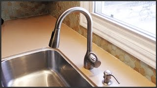 Removing Hard Water Deposits From A Faucet Head