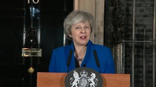 May speaks outside Downing Street after confidence vote