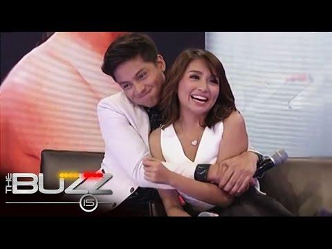 Daniel bear hugs Kathryn during Buzz interview