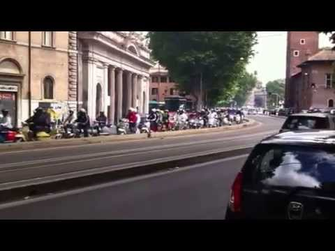 Parade of Vintage Vespa Scooters in Rome