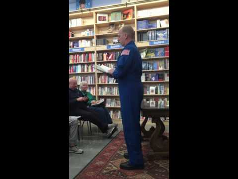 Astronaut Clayton Anderson reading from his book in Omaha