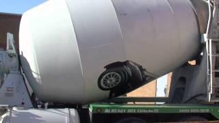 smart car lands on cement truck