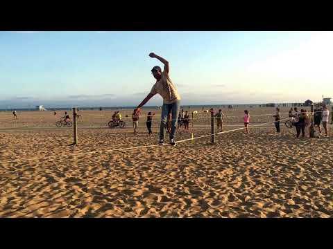 Learning basics tricks on a Trick Line.   Santa Monica Beach