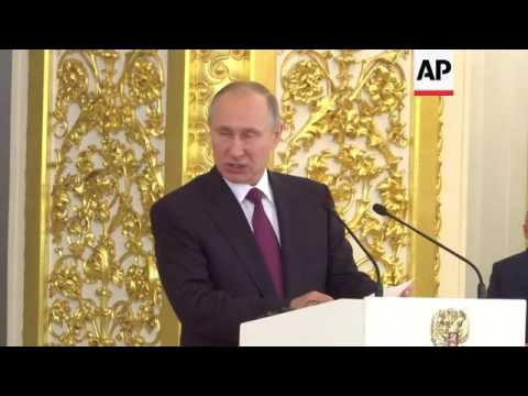 Putin presents Xi with Saint Andrew medal