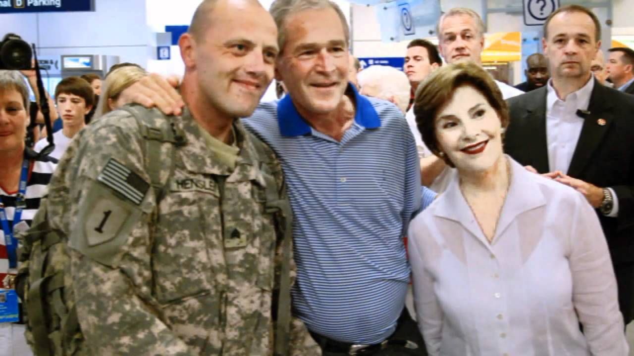 george and laura bush meet troops at airport