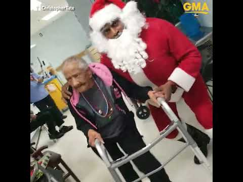 Elderly woman busts a move with Santa