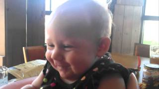 Very cute 5month old baby eating food, making funny faces and noises