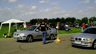 Drag Race - BMW 320i Vs. Nissan Almera N16 1,8
