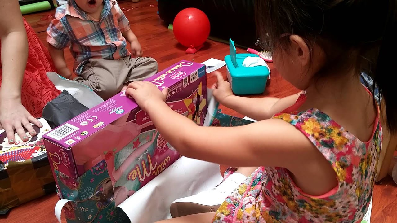 5 Year Old Girl Opening up Birthday Presents child kid