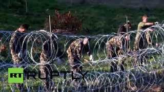 Slovenia: Army erect razor-wire fence on Croatian border to stem refugee flow