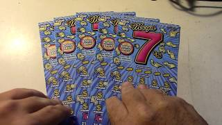 Playing 5 Fun Megs 7's California Lottery Scratchers