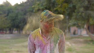 Closeup shot of handsome young man enjoying at Holi festival celebrated in India