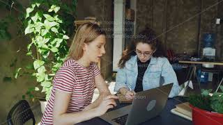 Ambitious enterpreneurs are developing business strategy sitting in modern loft style office and