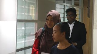 Wife of missing Perlis activist quizzed over 'Shia pictures'