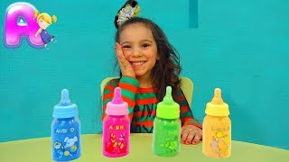 Anna Making Kinetic Sand Baby Milk Bottle