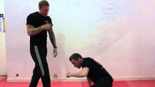 KRAV MAGA TECHNIQUES - BOWLING BALL TAKE DOWN(In this clip we look at a fast takedown from the front and the rear. Pressure against the eyes, lock the spine out and drive towards the floor. Remember to keep ..., 2013-04-06T10:11:50.000Z)