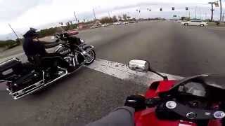 Rider drag races a motorbike cop