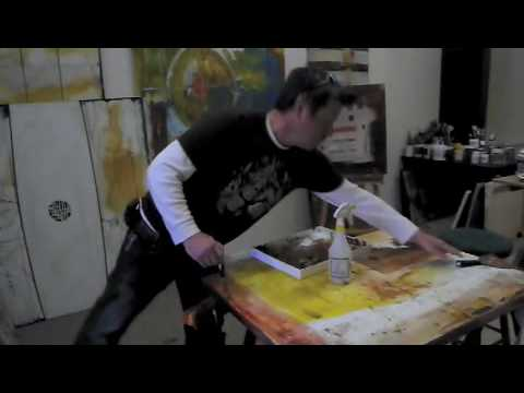 Abstract Artist Jason Coleman painting in his studio